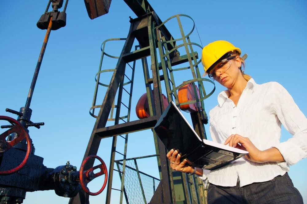 Woman working at oil refinery